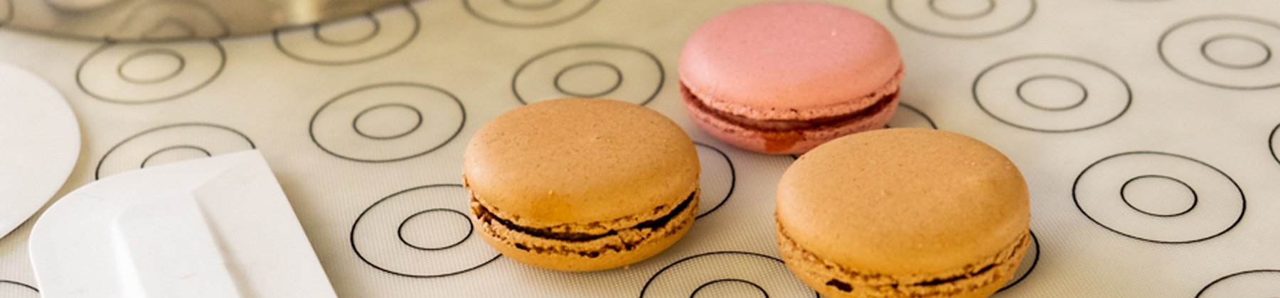 Photo of de Buyer macaron mat with colorful macarons sitting on top.