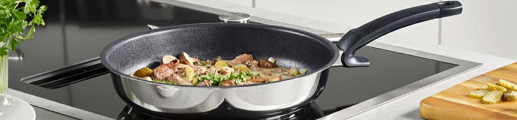 Photo of Fissler nonstick fry pan cooking potatoes on a stove.