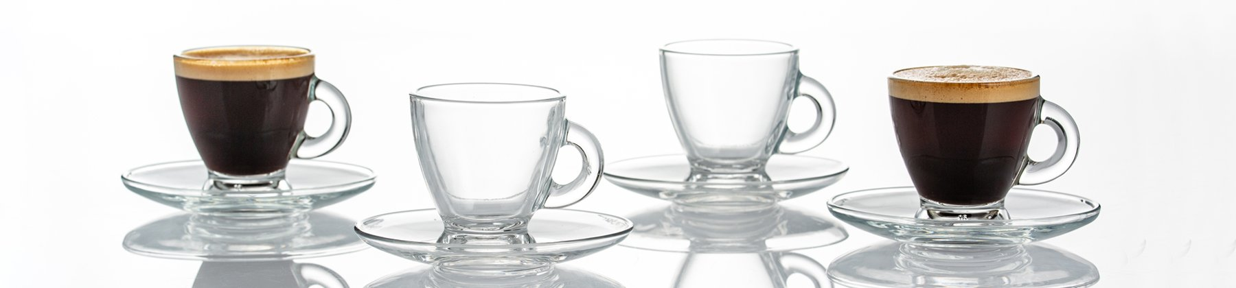 Photo of Ravenhead cappuccino & espresso glasses lined up on a table.