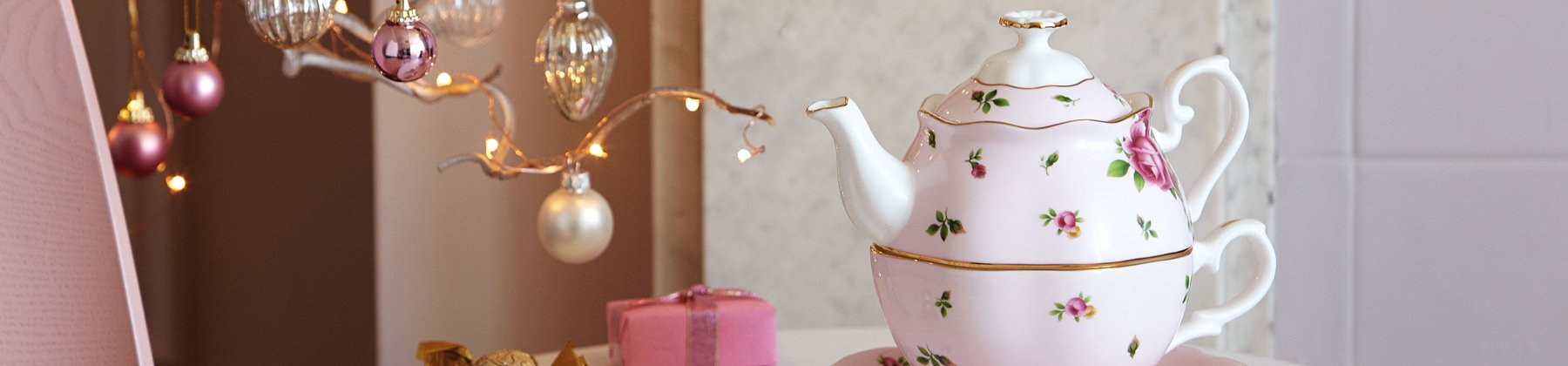Photo of Royal Albert teapot on a decorated table.